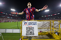 NASHVILLE, TN - SEPTEMBER 5: A capo for American Outlaws leads USA Fans in cheers during a game between Canada and USMNT at Nissan Stadium on September 5, 2021 in Nashville, Tennessee.