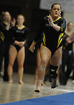 Towson University's Kady Sullivan competes on the vault during the Shelli Calloway Memorial Gymnastics Invitational at Towson University in Towson, Maryland.