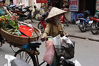 Hanoi<br /> , Vietnam - 2007 File Photo -<br /> <br /> A woman walk beside her bicycle while lots of scooters and motorcycles are parked on the sidewalk in Hanoi.<br /> <br /> <br /> <br /> photo : James Wong-  Images Distribution