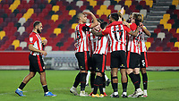 Brentford players congratulate Mads Bech Sorensen after scoring their third goal during Brentford vs Sheffield Wednesday, Sky Bet EFL Championship Football at the Brentford Community Stadium on 24th February 2021