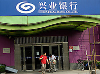 A branch of Industrial Bank Co.,LTD in Beijing, China. The Industrial Bank plans to raise as much as 50 billion yuan ($6.5 billion) in the nation's biggest bond sale to boost capital and finance loan growth..