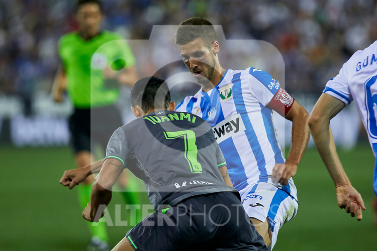 Leganes' Alexander Szymanowski and Real Sociedad's Juan Miguel Jimenez during La Liga match. August 24, 2018. (ALTERPHOTOS/A. Perez Meca)