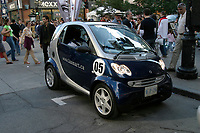 June 2004 File Photo, Montreal (Qc) Canada <br /> <br />  Smart Car on Sainte-Catherine Street in MOntreal<br /> Photo : (c) 2004, Pierre Roussel