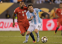 Action photo during the match Argentina vs Chile, Corresponding to Great Final of the America Centenary Cup 2016 at Metlife Stadium, East Rutherford, New Jersey.<br /> <br /> <br /> Foto de accion durante el partido Argentina vs Chile, correspondiente a la Gran Final de la Copa America Centenario 2016 en el  Metlife Stadium, East Rutherford, Nueva Jersey, en la foto: (i-d) Arturo Vidal de Chile y Lionel Messi de Argentina <br /> <br /> <br /> 26/06/2016/MEXSPORT/David Leah.