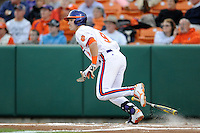 Clemson Tigers  right fielder Steven Duggar #9 runs to first during a game against the Virginia Cavaliers  at Doug Kingsmore Stadium on March 15, 2013 in Clemson, South Carolina. The Cavaliers won 6-5.(Tony Farlow/Four Seam Images).