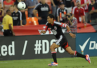 WASHINGTON, DC. - AUGUST 22, 2012:  Andy Najar (14) of DC United on the attack against the Chicago Fire during an MLS match at RFK Stadium, in Washington DC,  on August 22. United won 4-2.