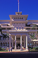 The Moana Hotel in Waikiki and tourists in front