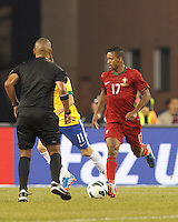 Portugal forward Nani (17) dribbles.  In an international friendly, Brazil (yellow/blue) defeated Portugal (red), 3-1, at Gillette Stadium on September 10, 2013.