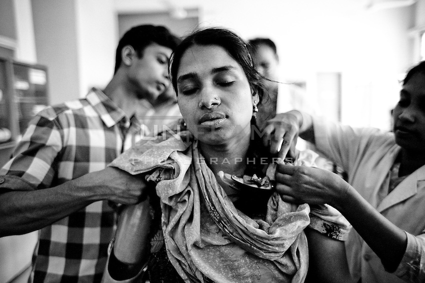 Rikta who lost her right arm at the Savar Building Collapse is being fitted with an Artificial arm  at CDD's Assistive Technology Resource Centre. Rikta had her right arm amputated inside the rubble when she was rescued nearly 72 hours after the building collapsed.