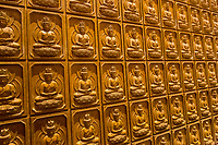 Nanjing, Jiangsu, China.  Buddhas Decorate Walls of the Hall of a Thousand Buddhas, Usnisa Palace, Niushou Mountain.