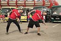 Football freestylers Oliver Hayes and  John Whetton entertain the supporters before boarding the buses