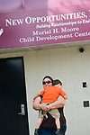 WATERBURY, CT-3 July 2014-070314EC08--   Dennis Nunez, 4, and his grandmother Irma Lopez, walk out of the former New Opportunities program along North Main Street in Waterbury. It is being taken over by Community Development Institute. Erin Covey Republican-American