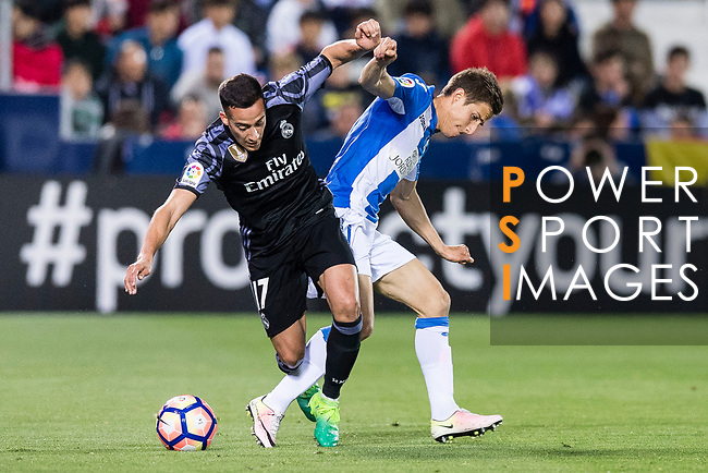 Lucas Vazquez of Real Madrid competes for the ball with Alexander Szymanowski of Deportivo Leganes during their La Liga match between Deportivo Leganes and Real Madrid at the Estadio Municipal Butarque on 05 April 2017 in Madrid, Spain. Photo by Diego Gonzalez Souto / Power Sport Images