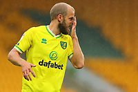 3rd October 2020; Carrow Road, Norwich, Norfolk, England, English Football League Championship Football, Norwich versus Derby; Teemu Pukki of Norwich City wipes his face during heavy rain