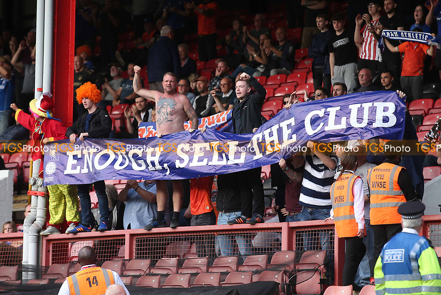 Oldham fans protest with an 'Enough, Sell The Club' banner during Leyton Orient vs Oldham Athletic, Sky Bet EFL League 2 Football at The Breyer Group Stadium on 11th September 2021