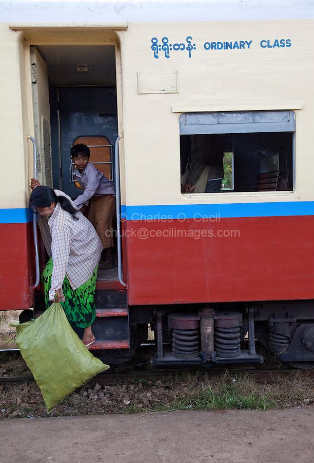 "Myanmar, Burma.  Passenger Leaving  Coach at Kalaw Train Station.  ""Ordinary Class."""