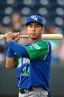 Shortstop Cristian Perez (15) of the Lexington Legends warms up before a game against the Greenville Drive on Sunday, September 2, 2018, at Fluor Field at the West End in Greenville, South Carolina. Greenville won, 7-4. (Tom Priddy/Four Seam Images)
