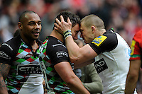 George Lowe of Harlequins (centre) celebrates his try with team mates Mike Brown (right) and Jordan Turner-Hall during the Aviva Premiership match between Saracens and Harlequins at Wembley Stadium on Saturday 31st March 2012 (Photo by Rob Munro)