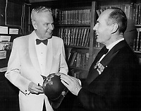 Former Prime Minister John Diefenbaker and Leonard Cheshire, a wartime commander of the Royal Air Force 617 (Dambusters) Squadron, examine World War I German helmet at the Royal Canadian Military Institute, where Diefenbaker addressed Dambusters last night during their first reunion held in Canada.<br /> <br /> Photo : Boris Spremo - Toronto Star archives - AQP