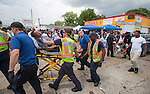 BATON ROUGE, LA -JULY 09:  Paramedics remove a victim of the 100 degree heat index from a protest over the Alton Sterling shooting in Baton Rouge, Louisiana July 9, 2016.  Sterling was shot and killed by police on July 5, 2016 in Baton Rouge, Louisiana. (Photo by Mark Wallheiser/Getty Images)