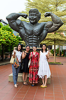 Gan Boon Leong Statue, Father of Malaysian Bodybuilding, and Chinese Women Tourists, Melaka, Malaysia.