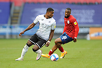 Swansea City's Marc Guehi is closely watched by Huddersfield Town's Isaac Mbenza<br /> <br /> Photographer Ian Cook/CameraSport<br /> <br /> The EFL Sky Bet Championship - Swansea City v Huddersfield Town - Saturday 17th October 2020 - Liberty Stadium - Swansea<br /> <br /> World Copyright © 2020 CameraSport. All rights reserved. 43 Linden Ave. Countesthorpe. Leicester. England. LE8 5PG - Tel: +44 (0) 116 277 4147 - admin@camerasport.com - www.camerasport.com