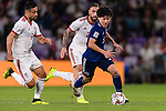 Minamino Takumi of Japan (R) in action during the AFC Asian Cup UAE 2019 Semi Finals match between I.R. Iran (IRN) and Japan (JPN) at Hazza Bin Zayed Stadium  on 28 January 2019 in Al Alin, United Arab Emirates. Photo by Marcio Rodrigo Machado / Power Sport Images
