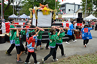 August 11 2012 - Montreal (Qc) Canada - Matsuri Japon Festival 11th edition.<br /> <br /> Children and teens carry a smaller mikoshi to celebrate the opening of the 2012 Matsuri Japon Festival<br /> <br /> <br /> <br /> Matsuri Japon is a free event promoting Japanese culture to the general public.