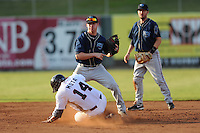 The Mobile BayBears second baseman Jake Elmore #6 makes the turn in an attempted double play during  game four of the Southern League Championship Series between the Mobile Bay Bears and the Tennessee Smokies at Smokies Park on September 18, 2011 in Kodak, Tennessee.  The BayBears won the Southern League Championship 6-4.  (Tony Farlow/Four Seam Images)
