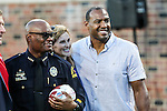 Dallas Police Chief, David Brown, and former Dallas Cowboy, Darren Woodson, in action before the game between the TCU Horned Frogs and the SMU Mustangs at the Gerald J. Ford Stadium in Dallas, Texas.