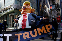 NEW YORK, NEW YORK - MARCH 08: People attend a protest against the former U.S. president Donald Trump at Trump Tower on March 08, 2021 in New York. Trump is returning to New York for the first time after leaving the White House at a time when several New York prosecutors are investigating his businesses for possible fraud crimes. (Photo by John Smith/VIEWpress)