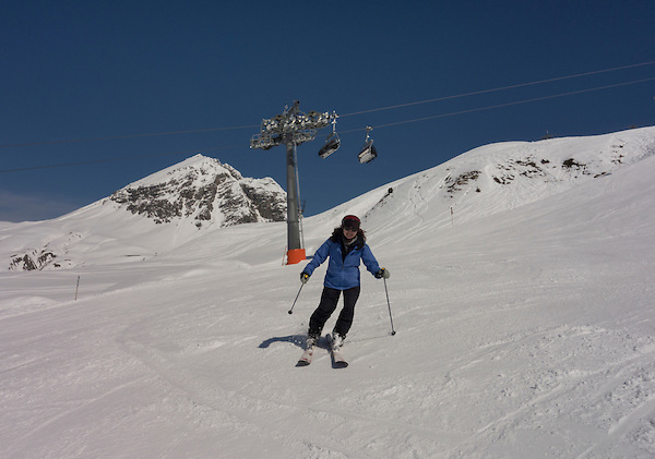 Woman skiing at Zurs Ski Area in St Anton, Austria, .  John leads private ski trips to Front Range and Summit County Ski Areas in Colorado.
