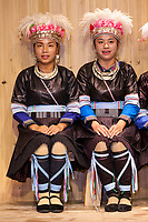 Zhaoxing, Guizhou, China.  Two Young Women of the  Dong Ethnic Minority Singing in a Traditional Music Performance.