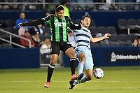 KANSAS CITY, KS - MAY 9: Cecilio Dominguez #10 Austin FC fights for the ball with Luis Martins #36 Sporting KC during a game between Austin FC and Sporting Kansas City at Children's Mercy Park on May 9, 2021 in Kansas City, Kansas.
