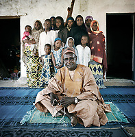 Ibrahim Sanda, Chief of the village of Sarki, hosts nineteen women and children at his home in the extreme-north of Cameroon. <br /> <br /> Ibrahim Sanda is one of the many residents of Mokolo who have opened their doors and welcomed people who have fled the conflict. His guests are from two different families from a town about 20 miles away near the border with Nigeria. Although residents give them rice, adults only eat once a day and children eat twice, with porridge in the morning. Only two boys from the families go to school because it's too expensive. <br /> <br /> 'It's important that people know they can come here with this security situation. Since August 2014 people have been running here with the attacks on their villages. There was no assistance for these people, so we brought them into our house. We take care of the people. There are no international NGOs here. <br /> <br /> 'The concern is about peace. We need peace where they've come from. We give the fees for school for some of the children and every time I can, food for the families. The children are malnourished because the mothers do not have any livelihoods, they just depend on the assistance that they receive and it's not a lot and that's why most of the children have malnutrition here. The majority of children in Mokolo are suffering from malnutrition and health problems. Nobody knows what kind of future we have.<br /> <br /> 'If you see people you can assist, you have to do that with money or the means that you have. It's normal for me to help these people. In the past I had one bag of maize to feed myself and my family, now with all these people I need three bags of maize and it's quite difficult for me. The costs are increasing. I need more money to support all these people.'