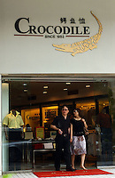 A Crocodile fashions store in downtown Shenzhen, south China.  The Crocodile brand is a blatant rip-off of the French brand Lacoste and have been taken to court by the French company..02 Jun 2005
