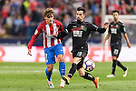 Antoine Griezmann of Atletico de Madrid fights for the ball with Isaac Cuenca of Granada CF during their La Liga match between Atletico de Madrid and Granada CF at the Vicente Calderon Stadium on 15 October 2016 in Madrid, Spain. Photo by Diego Gonzalez Souto / Power Sport Images
