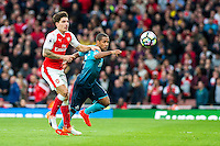 Wayne Routledge ( right ) chases the ball during the Premier League match between Arsenal and Swansea City at Emirates Stadium on October 15, 2016 in London, England.