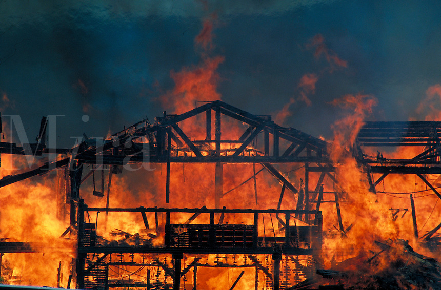 building on fire engulfed in flames and smoke. burn, burned, flames, fire, hot, insurance, loss, damage, arson. California.