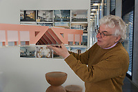 Switzerland. Canton Ticino. Mendrisio. The architect Mario Botta in his office. Architectural model of the Luxun university and campus in Shenyang, People's Republic of China. On the wall, rolls of blueprints with architectural plans and technical drawings, and 3D pictures. Shenyang, formerly known by its Manchu name Mukden or Fengtian is the provincial capital and the largest city of Liaoning Province. 30.10.2017 © 2017 Didier Ruef
