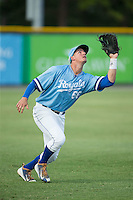 Burlington Royals left fielder Brandon Thomasson (66) tracks a fly ball during the game against the Danville Braves at Burlington Athletic Park on August 13, 2015 in Burlington, North Carolina.  The Braves defeated the Royals 6-3. (Brian Westerholt/Four Seam Images)