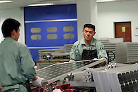 Workers assemble solar power panels at the Suntech factory in Wuxi, China. Suntech is one of the world's top 10 manufacturers of PV cells based on production output..16 Nov 2005