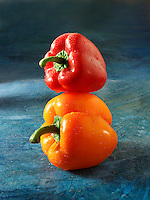 Mixed red & orange fresh bell peppers photos, pictures & images