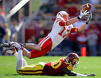 Nebraska wide receiver Todd Peterson tries to make a catch over Iowa State defensive back Brandon Hunley (20) during the third quarter at Jack Trice Stadium in Ames, Iowa Saturday, October 18, 2008. The pass fell incomplete.