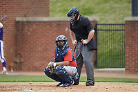 NJIT Highlanders catcher Edgar Badaraco (28) looks to the dugout for a sign as home plate umpire Chris Barneycastle looks on during the game against the High Point Panthers at Williard Stadium on February 18, 2017 in High Point, North Carolina. The Highlanders defeated the Panthers 4-2 in game two of a double-header. (Brian Westerholt/Four Seam Images)