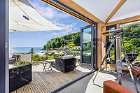 BNPS.co.uk (01202) 558833<br /> Pic: MarchandPetit/BNPS<br /> <br /> Pictured: The panoramic view of the bay.<br /> <br /> A stunning contemporary home just a stone's throw from an idyllic beach is on the market for £3.85m.<br /> <br /> The aptly-named Beach House was designed to take advantage of its breath-taking views over North Sands Beach and out to sea.<br /> <br /> The four-bedroom oak-framed house is in a fantastic plot in one of the most sought after locations in Salcombe, Devon.<br /> <br /> As well as an expansive balcony to enjoy the views, it also has boat storage - a rarity in the town.