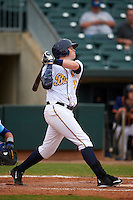 Montgomery Biscuits first baseman Cameron Seitzer (33) hits a home run during a game against the Tennessee Smokies on May 25, 2015 at Riverwalk Stadium in Montgomery, Alabama.  Tennessee defeated Montgomery 6-3 as the game was called after eight innings due to rain.  (Mike Janes/Four Seam Images)