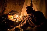 UKRAINE, Shyrokyne: Nekratov is giving some orders to one of his comrade before sleeping in the shelter. <br /> <br /> UKRAINE, Shyrokyne: Nekratov donne des ordres à un de ses camarades avant de dormir dans l'abris de la tranchée.