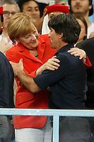 Germany manager Joachim Low hugs Germany Chancellor Angela Merkel