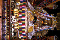 A golden buddha statue inside a temple at Zhongdian, Yunnan province, China..18-DEC-02